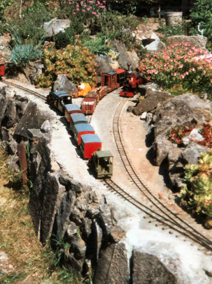 East side of the central rockery viewed from garden path. Colin Binnie`s garden railway in Somerset